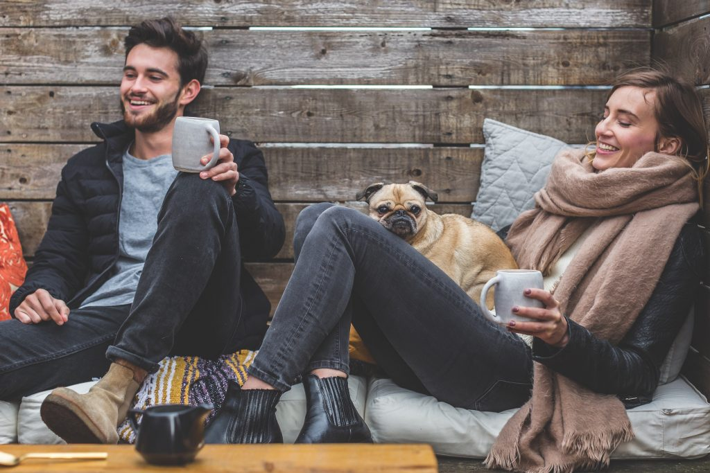 couple with cold cozy dog